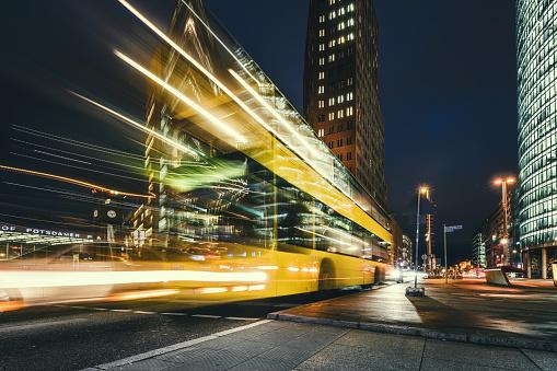 Traffic「yellow bus on Potsdamer Platz at blue hour」:スマホ壁紙(0)