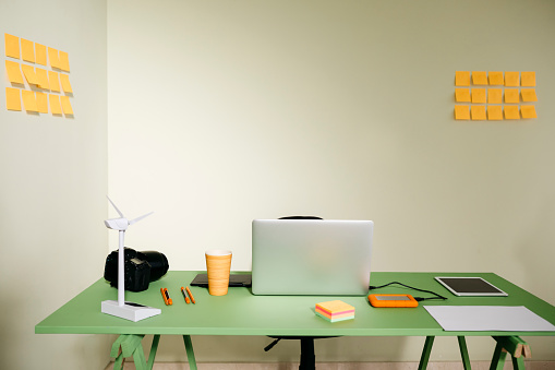 Small Office「Desk in office with laptop, wind turbine and a camera」:スマホ壁紙(7)