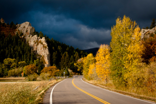 Aspen Tree「Highway with trees in fall color and stormy sky.  Walsenburg, Colorado.」:スマホ壁紙(0)