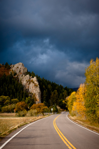 Aspen Tree「Highway with trees in fall color and stormy sky.  Walsenburg, Colorado.」:スマホ壁紙(2)