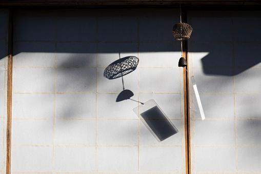 Takayama City「Japan, Takayama, Traditional wind chime hanging in front of house in Hida Folk Village」:スマホ壁紙(10)