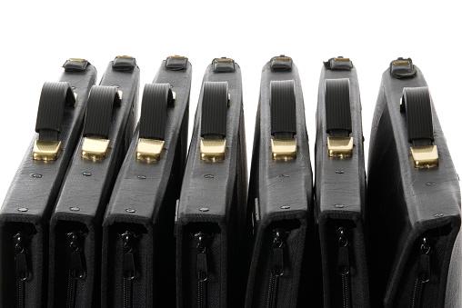 Briefcase「Row of black portfolio against white background」:スマホ壁紙(13)