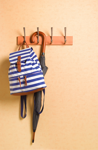 Umbrella「Rucksack hanging ready on coat hook in hallway」:スマホ壁紙(10)