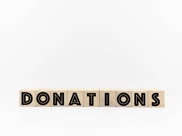 Donations Word Written On Wooden Cubes or Block. Concepts with White Backgrounds.:スマホ壁紙(壁紙.com)