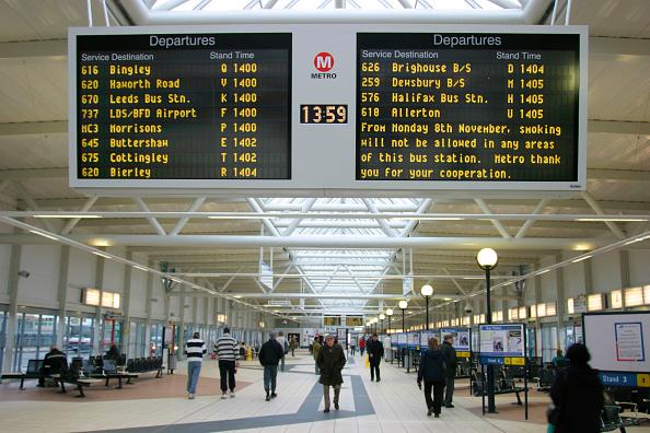 Travel Destinations「Passengers wait for busses under the shadow of the electronic destination board at Bradford Interchange station. November 2004.」:写真・画像(12)[壁紙.com]