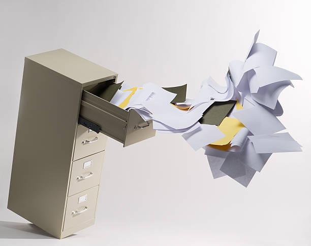 Files flying out of file cabinet:スマホ壁紙(壁紙.com)
