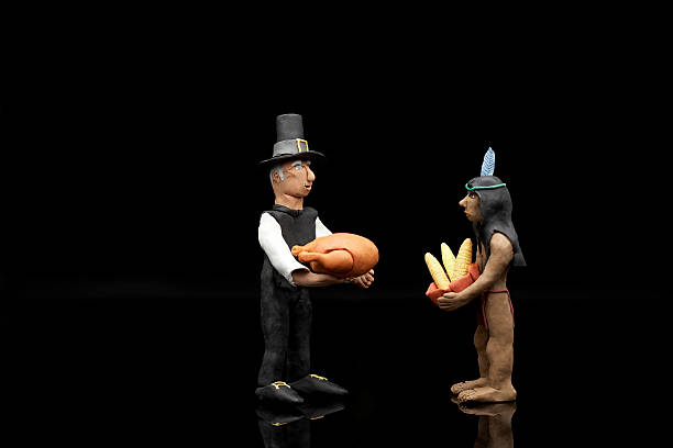 Clay model of Pilgrim and Native American Indian figures with a turkey and bowl of corn:スマホ壁紙(壁紙.com)