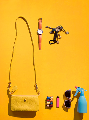 Key「Purse and summer accessories on yellow background」:スマホ壁紙(11)