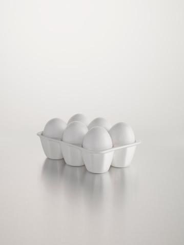 Animal Egg「White egg holder against white background」:スマホ壁紙(16)