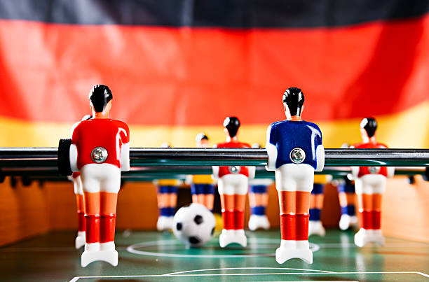 Playing for Germany: foosball game against German national flag.:スマホ壁紙(壁紙.com)