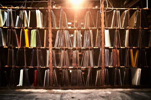 Glass Factory「Assortment of stained glass on shelf in a factory warehouse」:スマホ壁紙(11)