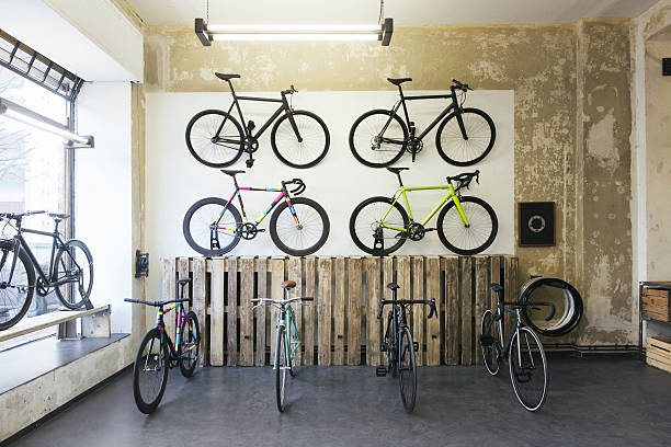 Assortment of racing cycles in a custom-made bicycle store:スマホ壁紙(壁紙.com)