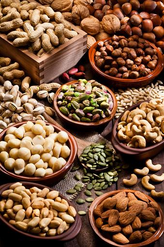 Pine Nut「Assortment of nuts on rustic wood table.」:スマホ壁紙(2)