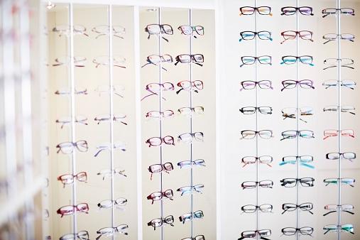 Eyewear「Assortment of glasses in an optician shop」:スマホ壁紙(1)