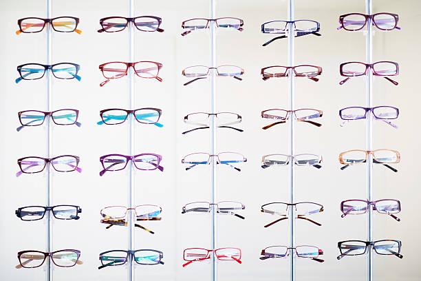 Assortment of glasses in an optician shop:スマホ壁紙(壁紙.com)