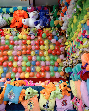 Stuffed Animals「Balloons and stuffed toy prizes at carnival game」:スマホ壁紙(3)