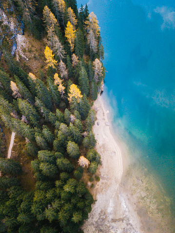 Alto Adige - Italy「Aerial drone view of forest and alpine lake」:スマホ壁紙(0)