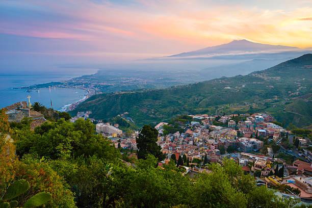 Italy, Sicily, Taormina with Mount Etna at sunset:スマホ壁紙(壁紙.com)