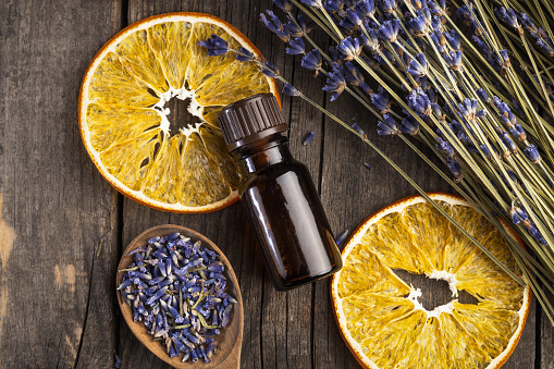 Health Spa「Essential oil lavender and orange dry on a wooden table, top view」:スマホ壁紙(4)