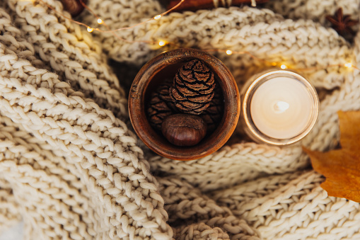 Pine Cone「Autumn leaf, Pine cones and a candle with knitted scarf」:スマホ壁紙(6)