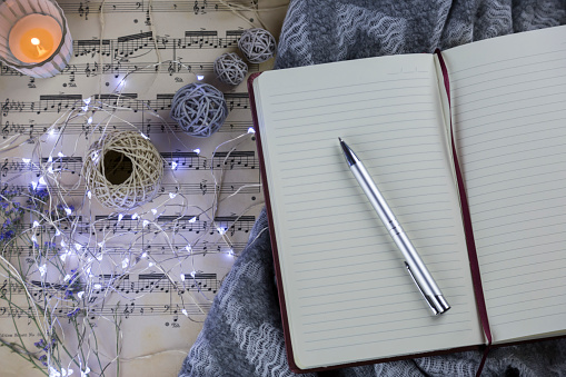 Personal Organizer「Pencil on notebook and fairy lights on music sheet」:スマホ壁紙(18)