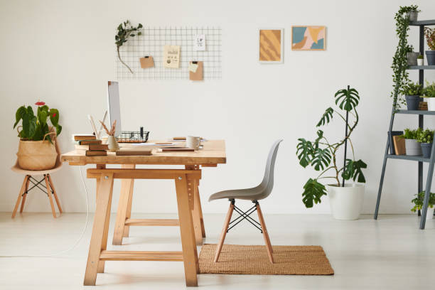 Eco home office with wooden table, various potted plants and modern computer:スマホ壁紙(壁紙.com)