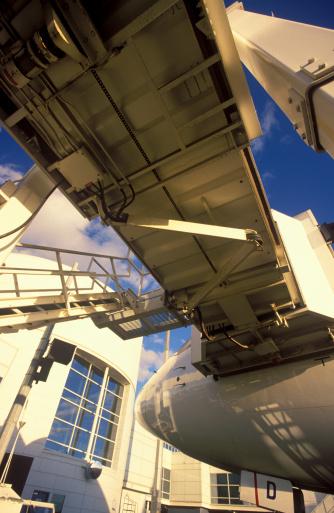 Passenger「Australia, Melbourne, passenger boarding bridge attached to plane, low angle view」:スマホ壁紙(7)