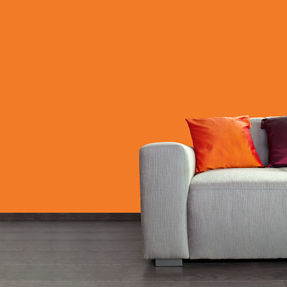 Fashion「Modern gray sofa and colorful pillows against orange wall」:スマホ壁紙(18)