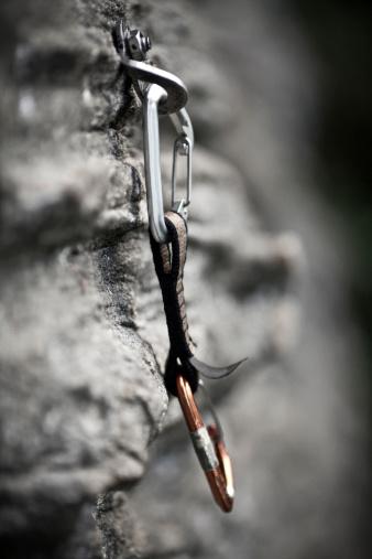 エクストリームスポーツ「Rock climbing equipment hangs from a rock face.」:スマホ壁紙(3)