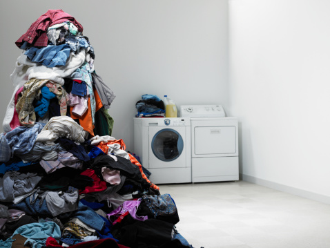 Clothing「Laundry room with tall pile of clothes.」:スマホ壁紙(12)