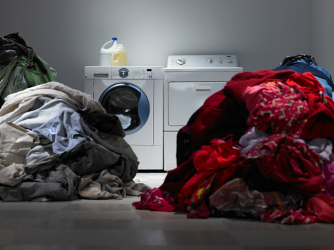 Washing「Laundry room with piles of sorted clothes」:スマホ壁紙(3)