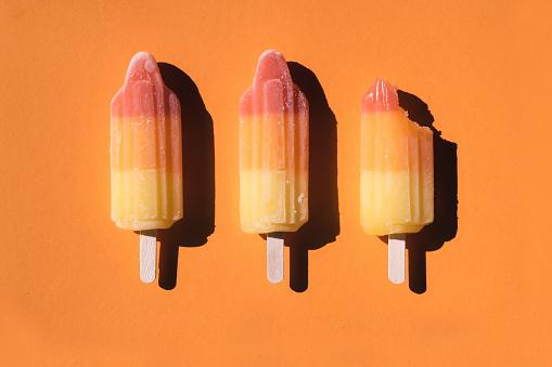 Belgium「Directly above shot of sorbets arranged on orange background」:スマホ壁紙(2)