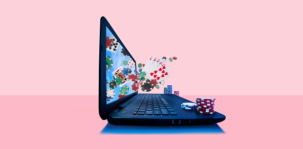 Portability「Playing cards and gambling chips emerging from laptop screen」:スマホ壁紙(5)