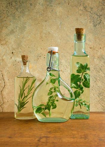 Sensory Perception「Olive oil bottles with mint, rosemary and oregano leaves」:スマホ壁紙(19)