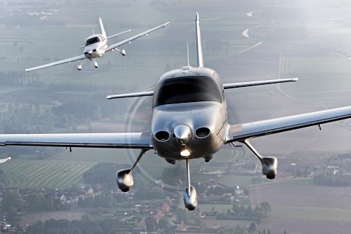 Propeller Airplane「propeller modern airplanes flying in formation」:スマホ壁紙(17)