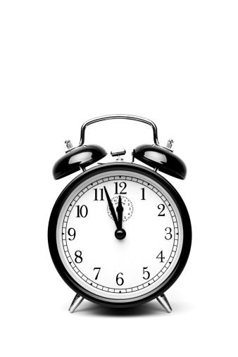 Bell「Black alarm clock on a white background」:スマホ壁紙(14)
