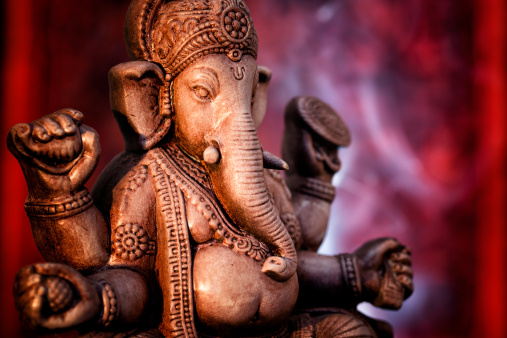 Indigenous Culture「A statue of Ganesha, a deity of India on red background」:スマホ壁紙(19)