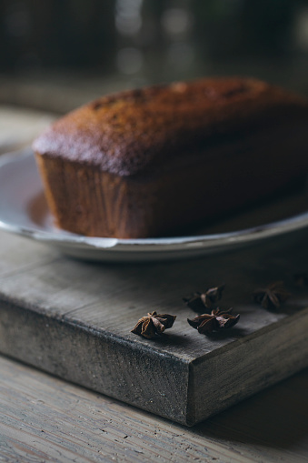 Star Anise「Star anise and Christmas cake in the background」:スマホ壁紙(5)