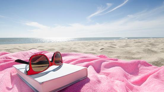 Nantucket「Book and sunglasses on pink towel on sandy beach」:スマホ壁紙(14)