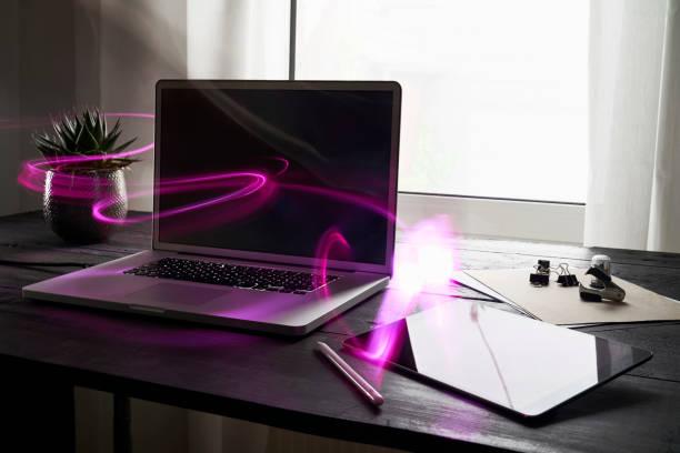Modern office with laptop and digital tablet on desk:スマホ壁紙(壁紙.com)