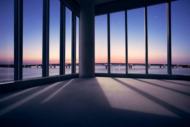 Modern office with window view of large bridge across river:スマホ壁紙(壁紙.com)