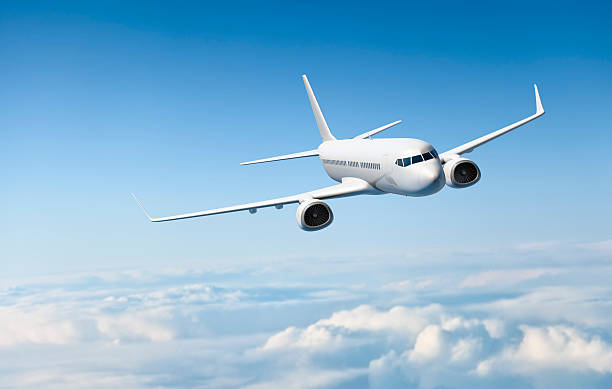 White passenger aircraft flying over clouds:スマホ壁紙(壁紙.com)