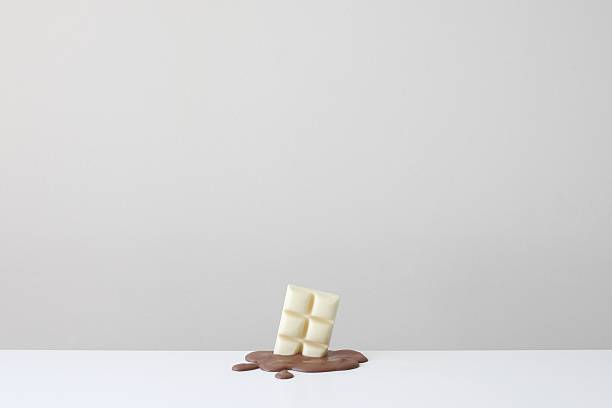 Conceptual bar of white chocolate in a pool of melted milk chocolate:スマホ壁紙(壁紙.com)
