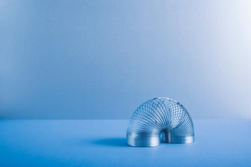 Blue Background「Metal coil toy」:スマホ壁紙(9)