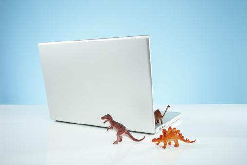 Threats「Toy dinosaurs emerging from Laptop」:スマホ壁紙(15)
