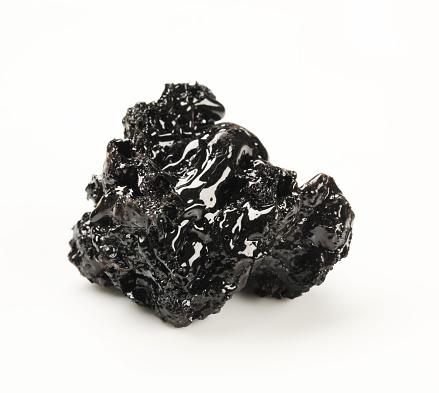 Tar「A brick of black tar on a white background」:スマホ壁紙(1)