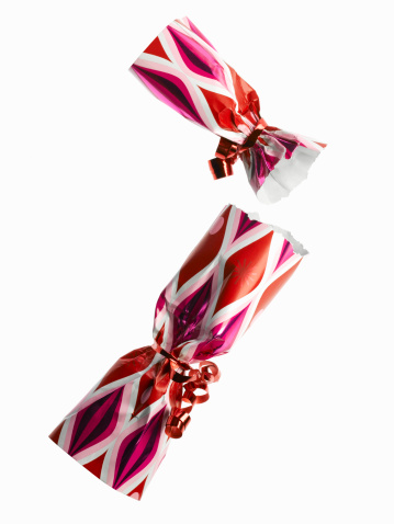 Christmas Cracker「Two red and pink party cracker on white background」:スマホ壁紙(13)