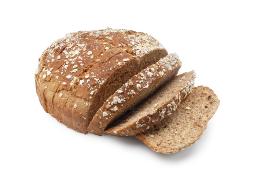 Loaf of Bread「A loaf of brown sesame seed bread with three slices cut」:スマホ壁紙(8)