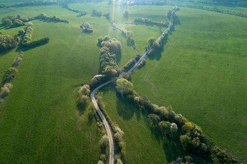 Atmospheric Mood「Rural Road through meadows with trees in spring, aerial view. Franconia, Bavaria, Germany.」:スマホ壁紙(16)