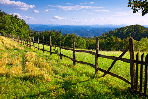 Pasture「Farm pasture surrounded by a wooden fence」:スマホ壁紙(4)